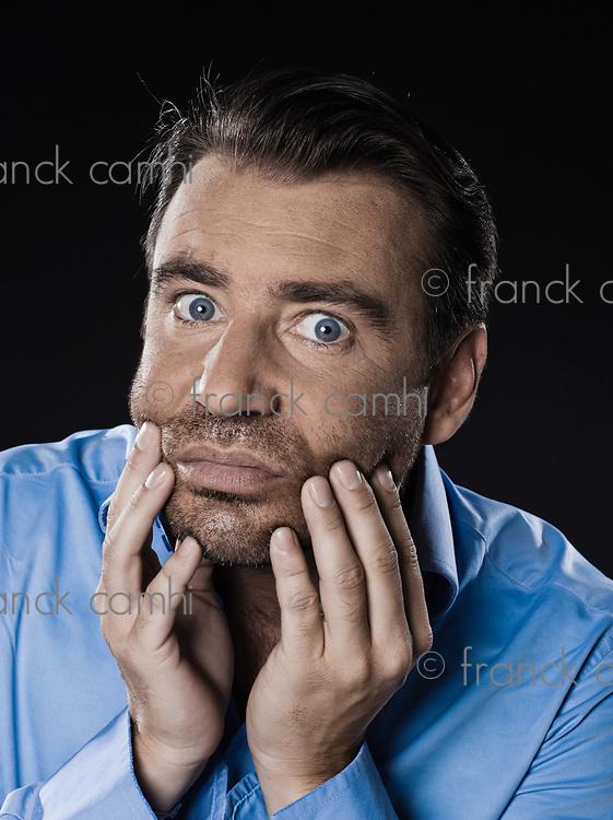 caucasian man unshaven hangover portrait isolated studio on black background