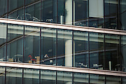 An informal meeting taking place by outer windows of an auditing company's London headquarters