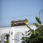 The Bondinho, tram or trolley car heads across the Arcos da Lapa, the Lapa Aquaduct, an impressive aqueduct heading to and from the Rio de Janeiro city centre to Santa Teresa in the hills of the city. The aquaduct was constructed in the mid-18th century by colonial authorities. Rio de Janeiro,  Brazil. 2nd September 2010. Photo Tim Clayton.