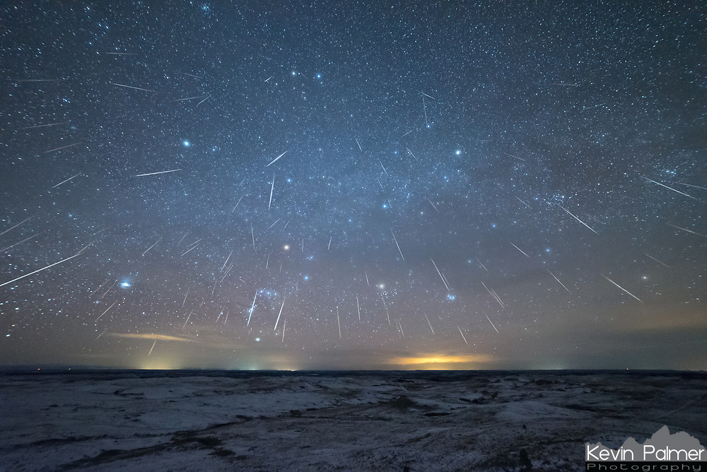 The Geminid Meteor Shower was very active in 2018. In this image I stacked a total of 90 meteors which my camera captured while pointed west. In about 5 hours and using 2 cameras, I captured a total of 350 shooting stars. It was a very active meteor shower this year. Near the top of the frame are the twin stars of Gemini, named Castor and Pollux. If you trace back the tails of the meteors this is where they appear to radiate from. The source of these streaks of light are small pieces of debris left behind by an asteroid, which burn up when they enter Earth's atmosphere at 22 miles per second. Thin clouds were making halos around the brighter stars. Overall the weather was perfect with the thicker clouds clearing out just as activity started to pick up after midnight.