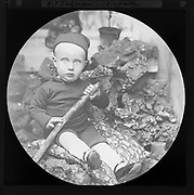 Family portrait of 15 month old boy photographed c 1900 , England, UK - J C Todman