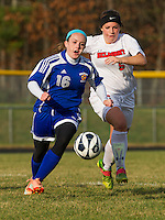 Gilford's Alex Harris and Belmont's Cassie Contigiani battle for possession of the ball during NHIAA first round Division III Soccer Wednesday afternoon.  (Karen Bobotas/for the Laconia Daily Sun)