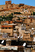 A view from a rooftop in Fes, Morocco shows the many changes in the city. The ancient Merinide Ruins that date back to the Roman empire are contrasted by many satellite dishes on Tuesday, May 29, 2007. (PHOTO BY TIMOTHY D. BURDICK)