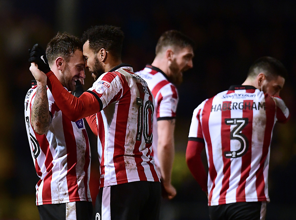 Lincoln City's Neal Eardley, left, celebrates scoring the opening goal with team-mate Matt Green<br /> <br /> Photographer Chris Vaughan/CameraSport<br /> <br /> The EFL Sky Bet League Two - Lincoln City v Cheltenham Town - Tuesday 13th February 2018 - Sincil Bank - Lincoln<br /> <br /> World Copyright © 2018 CameraSport. All rights reserved. 43 Linden Ave. Countesthorpe. Leicester. England. LE8 5PG - Tel: +44 (0) 116 277 4147 - admin@camerasport.com - www.camerasport.com