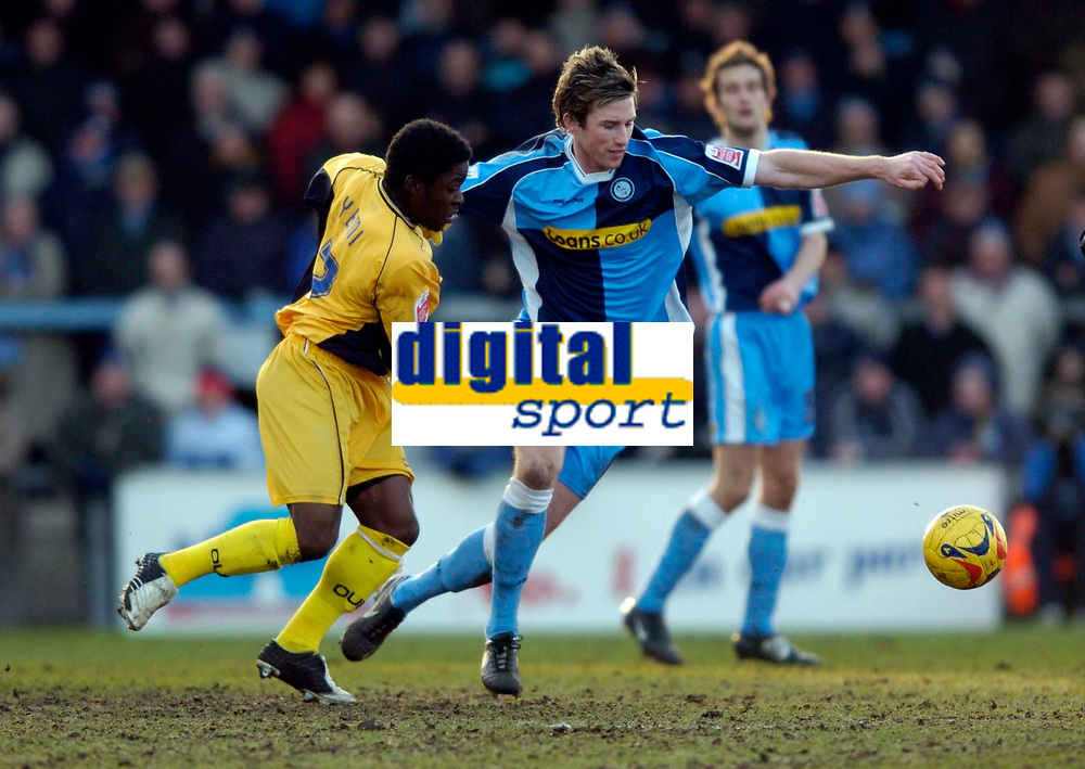 Photo: Richard Lane.<br />Wycombe Wanderers v Oxford United. Coca Cola League 2. 25/02/2006. <br />Wycombe's Rob Lee is challenged by Oxford's Yemi Odubade.