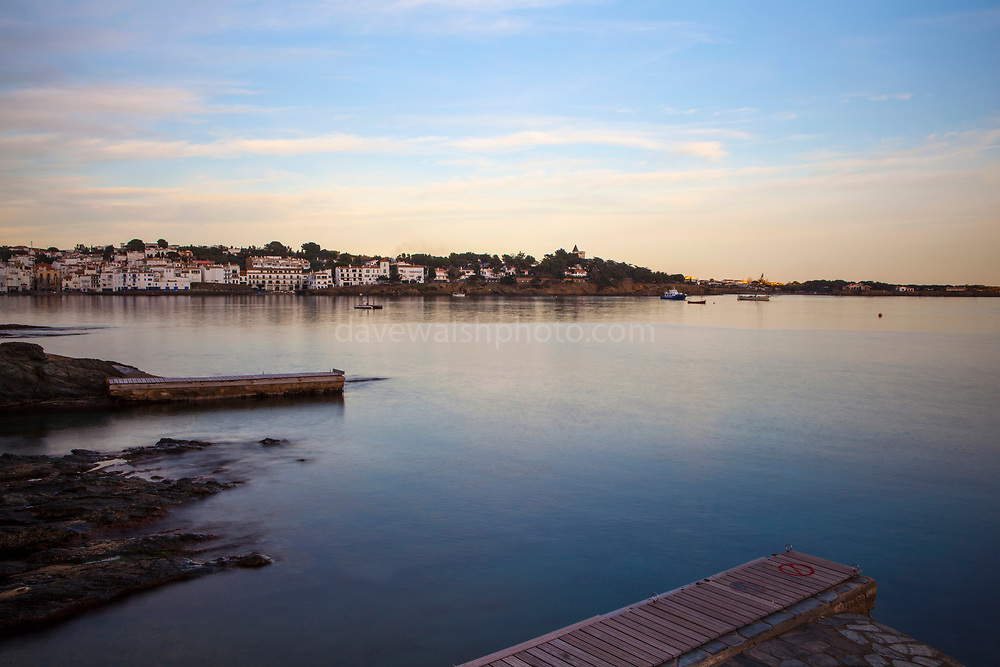 Long exposure, December light falls on the harbour jetty in Cadaqués, Catalonia.