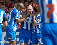 Photo: Ashley Pickering.<br /> Colchester United v Sunderland. Coca Cola Championship. 21/04/2007.<br /> Wayne Brown (no. 5) is congratulated by team mates after he scores the opening goal for Colchester