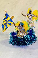 Flag bearer (porta bandeira) and mestre-sala  (man) in the Carnaval parade of Paraiso do Tuiuti samba school in the Sambadrome, Rio de Janeiro, Brazil.