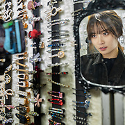 Nai Nai, a 23-year-old live-streamer in Shanghai, China, shops for accessories in Wuhan city. Nai Nai's fans are mostly Chinese men between 15 and 30 years old who post messages and virtual gifts, visible to everyone logged on to her chatroom. China's livestreaming industry reached 425 million subscribers in 2018 out of a current total internet user base of more than 829 million, according to government statistics cited in Chinese state media. Livestream hosting is an increasingly popular career choice, especially for young Chinese women like Nai Nai.