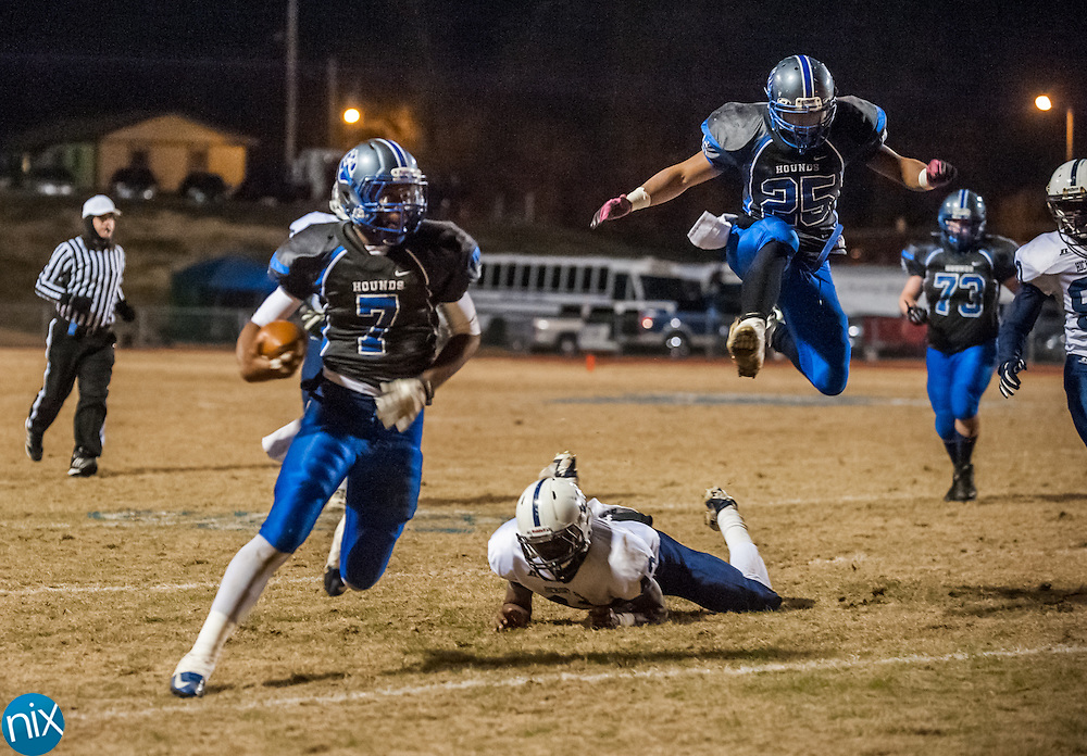 Statesville's Travis Ramseur (7) finds running room against Hickory Ridge Friday night during the second round of the NCHSAA Playoffs. Statesville won the game 39-30.