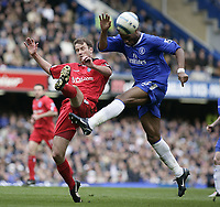 Didier Drogba and Kenny Cunningham. <br /> Chelsea v Birmingham. 09/04/05.