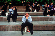A 1990s tired office worker has forty winks at lunchtime in Broadgate in the City of London (aka The Square Mile), the capital's financial centre, on 20th June 1993, in London, England. (Photo by Richard Baker / In Pictures via Getty Images)