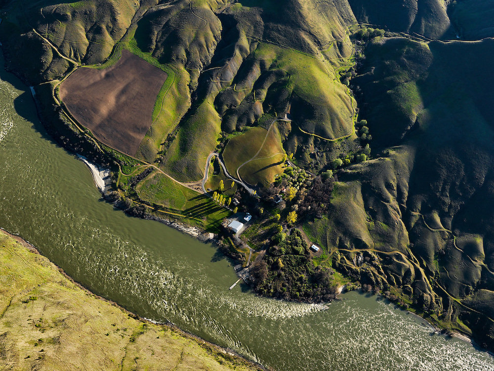 Aerial of River accessable only Garden Creek Ranch owned by the Nature Conservany on the Snake River in Hells Canyon south of Lewiston Idaho with Washington State on foreground side of river.