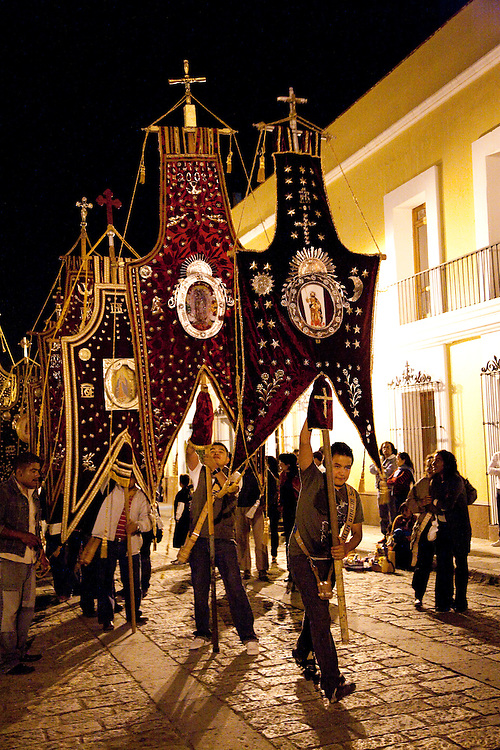 North America, Mexico, Oaxaca Province, Oaxaca,night procession with silk banners and Christian crosses on All Saints Day