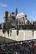 Views of the south east side of Notre Dame in Paris - here padlocks adorn Pont de l'Archevêché, just next to Notre Dame