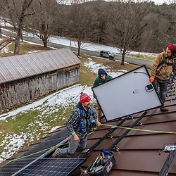 PV Squared employees installing solar panels on the roof of a barn in Shelburne, Massachusetts.