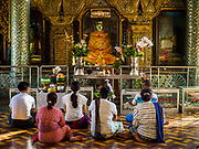18 NOVEMBER 2017 - YANGON, MYANMAR: People pray at Sule Pagoda in central Yangon. Pope Francis is visiting Myanmar, September 27-30. It will be the first visit by a Pope to the overwhelmingly Buddhist nation. He will meet with the Aung San Suu Kyi and other political leaders and will participate in two masses in Yangon. The Pope is expected to talk about Rohingya issue while he is in Myanmar. The Rohingya are persecuted Muslim minority in Rakhine state in western Myanmar. It's not clear how Myanmar's politically powerful nationalist monks will react if the Pope openly talks about the Rohingya. In the past, the monks have led marches and demonstrations against foreign diplomatic missions when foreign ambassadors have spoken in defense of the Rohingya. There is not much visible sign of the Pope's imminent visit in Yangon, which is estimated to be more than 90% Buddhist.    PHOTO BY JACK KURTZ