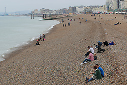 © Licensed to London News Pictures. 27/09/2014. Brighton, UK. Saturday September 27th 2014 on Brighton Beach. The weather is cloudy and temperatures are expected to be 18C in Brighton and the South Coast. Photo credit : Hugo Michiels/LNP