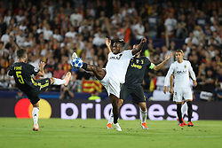 September 19, 2018 - Valencia, Spain - Michy Batshuayi of Valencia CF controls the ball under pressure from Miralem Pjanic of Juventus FC the UEFA Champions League, Group H football match between Valencia CF and Juventus FC on September 19, 2018 at Mestalla stadium in Valencia, Spain (Credit Image: © Manuel Blondeau via ZUMA Wire)