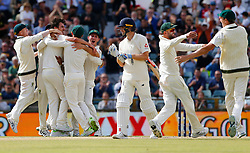Australia celebrate the final wicket of Chris Woakes to win the ashes during day five of the Ashes Test match at the WACA Ground, Perth.