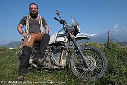 Bear Haughton poses with a spectacular background of 23,000' peaks on day-4 our our Himalayan Heroes adventure riding from Pokhara to Kalopani, Nepal. Friday, November 9, 2018. Photography ©2018 Michael Lichter.