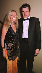 MISS ANNABEL HESELTINE and her fiancee MR PETER BUTLER, at a dinner in London on 1st December 1998.MMN 11