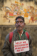 A blind man seeking aid in front of a traditional wall painting seeking aid for an operation on the 20th January 2018  in the city of Udaipur, India.