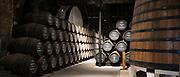 Caskets and vats in port wine cellars at Graham's Port Lodge in V|la Nova de Gaia in Porto, Portugal