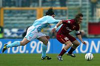 Roma 21/4/2004 Campionato Italiano Serie A <br />Lazio - Roma 1-1 <br />Giuliano Giannichedda (Lazio) and Francesco Totti (Roma)<br />Lazio and Roma are playing again after it was suspended on March 21, 2004, for security reasons.  <br />Foto Andrea Staccioli Graffiti