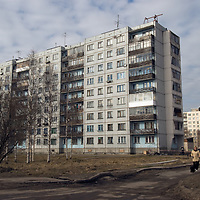 Russian women walk past modern apartment buildings in the northern port city of Arkhangel'sk.