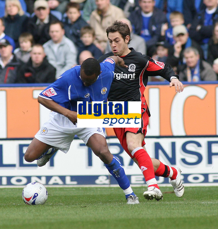 Photo: Mark Stephenson.<br /> Leicester City v Queens Park Rangers. Coca Cola Championship. 17/03/2007.Leicester's Darren Kenton holds off Qpr's Lee Cook