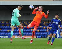 Football - 2020 /2021 Sky Bet League One - AFC Wimbledon vs Portsmouth - Plough Lane<br /> <br /> Ronan Curtis of Portsmouth challenges goalkeeper, Nik Tzanev of Wimbledon