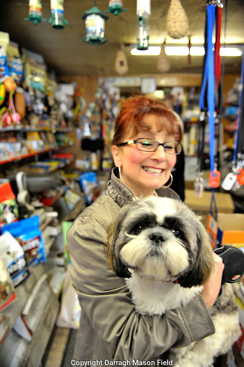 Lady with her dog in the Church Road pet shop