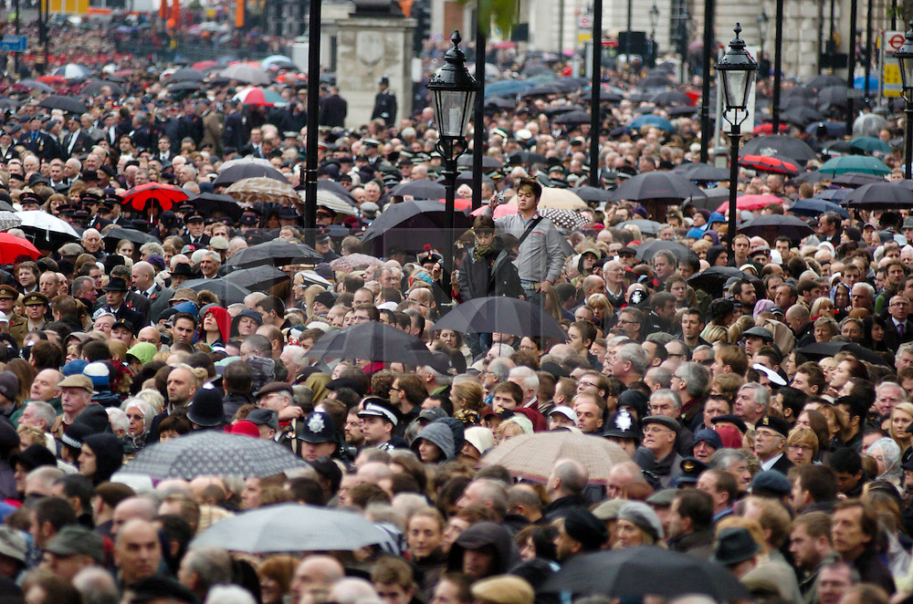 (c) London News Pictures. 13/11/2010.  Large crowds during Remembrance Sunday service at the Cenotaph. The Queen today (Sun) led the Remembrance Sunday service at the Cenotaph in London in honour of those who have died in wars and conflicts. Picture credit should read: Will Oliver/London News Pictures