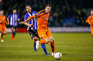 Luton Town defender Sonny Bradley (5) holds off Sheffield Wednesday midfielder George Boyd (21) during the The FA Cup 3rd round replay match between Luton Town and Sheffield Wednesday at Kenilworth Road, Luton, England on 15 January 2019.