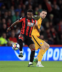 AFC Bournemouth's Jermain Defoe (left) and Brighton & Hove Albion's Shane Duffy battle for the ball during the Premier League match at the Vitality Stadium, Bournemouth.