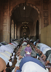 June 23, 2017 - Lahore, Punjab, Pakistan - Pakistani faithful Muslims offering Dua after offered prayer of Juma-tul-Wida (the last Friday of holy fasting Month of Ramazan before Eid-ul-Fitr), at historic Mughal era Badshahi Masjid in Lahore. Juma-tul-Wida was observed with religious zeal and fervor across the country. (Credit Image: © Rana Sajid Hussain/Pacific Press via ZUMA Wire)
