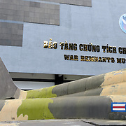 The exterior of the War Remnants Museum in Ho Chi Minh City (Saigon), Vietnam. In the foreground is part of a US Air Force F-111 bomber airplane.