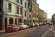 Cars parked on street historic buildings, thought to be Quimper, Brittany, France in 1974