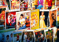 BURMA (MYANMAR) Shan State, Nyaungshwe, Inle Lake. 2006. The tastefulness of these calendars on display at an Intha market gives a sense of an essential Burmese decency.