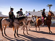 28 JANUARY 2012 - BUCKEYE, AZ:    The JayCees Commancheros prepare to ride in the Buckeye Days parade. The Buckeye Days parade went through downtown Buckeye, an agricultural community about 45 miles west of Phoenix. The parade was one the first events to mark Arizona's centennial celebration. Arizona was admitted to the United States on Feb 14, 1912, making it the 48th state in the union. The state celebrates its 100th birthday with a series of events on Feb. 14, 2012.    PHOTO BY JACK KURTZ