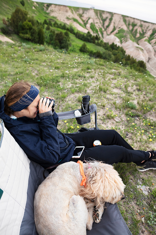 South Dakota, Badlands, National Park, National Forest, Bureau of land management, BLM, Roadtrip, travel, adventure, one, person, woman, dog, mutt, canine, relax, looking , binoculars, explore, United States