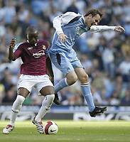 Photo: Aidan Ellis.<br /> Manchester City v West Ham United. The Barclays Premiership. 23/09/2006.<br /> West Ham's Nigel-Reo Coker getsw the ball from City's Dietmar Hamann (L)