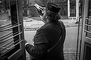 Conductor having a beer during a ride with an old tram during the celebration of 115 years of Zizkov.