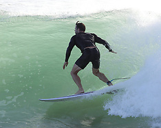 Chris Hemsworth shows off his surfing skills and ripped muscles - 22 March 2020