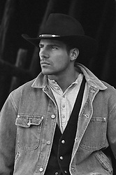 portrait of a rugged good looking cowboy