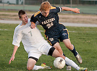 Hopkinton's Carter Rouleau and Bow's Edward Berke attempt to keep control of the ball during Monday's NHIAA Division III match at Hopkinton High School.  (Karen Bobotas/for the Concord Monitor)