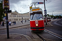 View of red and white trams traveling along the railway, Vienna, Austria.