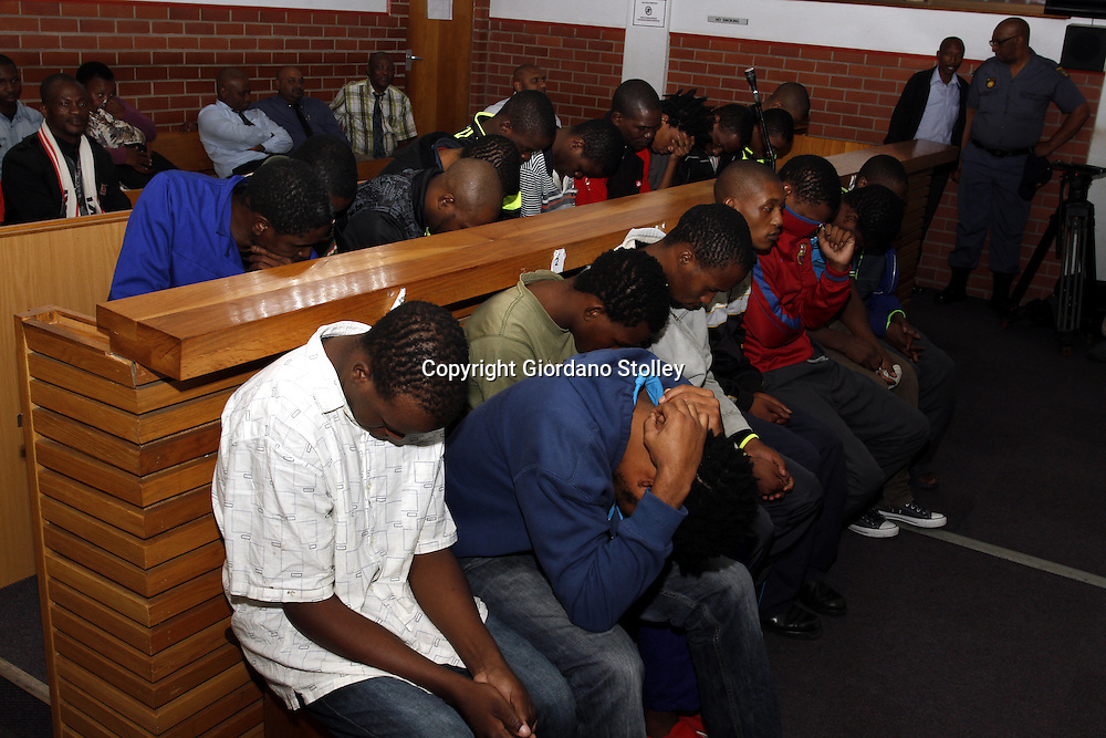 DURBAN - 17 December 2013 - Nineteen people acused of running a drug laboratory that manufactured mandrax and heroin keep their heads down in the Pinetown Magistrate's court. When the lab, located in Durban's upperclass Gillitts suburb, drugs with a street value of R41million was seized. Picture: Allied Picture Press/APP
