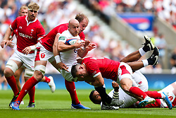 Willi Heinz of England is tackled by Alun Wyn Jones and Josh Adams of Wales - Rogan/JMP - 11/08/2019 - RUGBY UNION - Twickenham Stadium - London, England - England v Wales - Quilter Series.